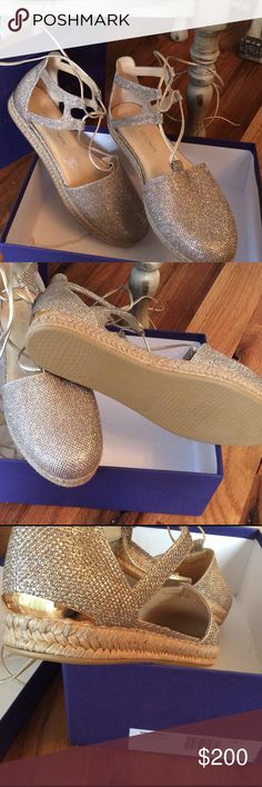 Stuart Weitzman sparkly platinum espadrilles! Stuart Weitzman 'walk my way' lace up platinum noir espadrilles 8.5M....more 'gilver' than silver in color, with gold leather gladiator straps.  New in box! Stuart Weitzman Shoes Espadrilles