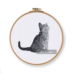 Geometric Black Cat cross stitch pattern Floss: DMC Colors: 10 Stitch size: 76 x 74 Stitches: full stitch, back stitch, three quarter stitch * Suggested fabric and size: Fabric: 14 count Designed area: 5.43 x 5.29 ------------------ PDF pattern contains: – Floss Palette – Color Symbol