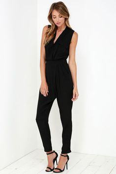 At first we thought it was just infatuation, but then we realized we are absolutely in the love with the You Send Me Black Jumpsuit! This sleeveless jumpsuit is made from a lightweight gauzy rayon, with a collarless neckline, and surplice bodice (fashioned with a modesty button) between decorative flap pockets. Elasticized waist lead into pleated pants with diagonal front pockets and a tapered cut. Decorative welted back pockets.