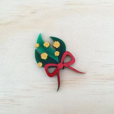 The Kaiju Candy Limited Edition Golden Wattle Brooch. Hand drawn laser cut wattle to adorn your body. Wattle size 6.5cm. Complete with a secure brooch backing with lock. IMPORTANT!! Please note that all our Kaiju Candy comes wrapped in tissue paper and WITHOUT a tin. You may purchase a protective collectors Kaiju Candy tin seperately HERE to add to your order.