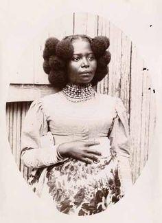 Africa | Portrait of a Nossi Bé woman. Madagascar. ca. 1920 | Photographer unknown.