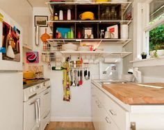 YES to hanging mugs  10 Organized and Efficient Small, Real Kitchens
