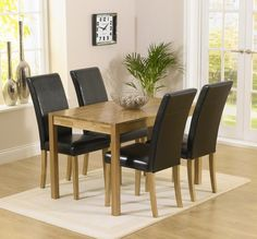 The Oxford Solid Oak Dining Table is crafted from solid oak and features a smooth resilient surface with a modern finger jointed design supported by sturdy solid oak legs. Available with Albany Chairs in black, brown, red, cream and grey. Four Seater Dining Table, Oak Extending Dining Table, Oak Dining Sets, Solid Oak Dining Table, Dining Table Design, Oak Table, Extendable Dining Table, Dining Table Chairs, Dining Area