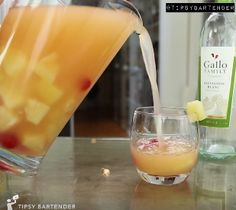 Pina Colada Sangria - For more delicious recipes and drinks, visit us here: www.tipsybartender.com
