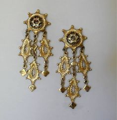 Monet Jewelry is a line of vintage costume accessories, such as necklaces, brooches and earrings. These pieces, used to give an outfit a classic, formal look, are made primarily of precious metals like silver and gold, and handcrafted for originality. SOLD