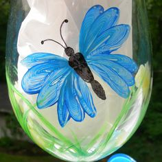 Blue Butterfly hand painted wine glass by GlassesbyJoAnne on Etsy, $20.00