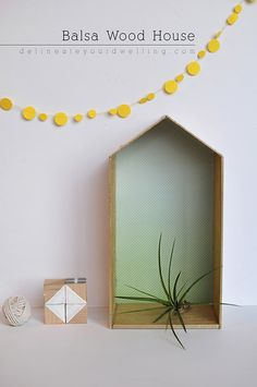 Summer is the perfect time to change up your home decor. Try these DIY home accents that will create an uplifting feel to your kitchen, entryway, or living room. This balsa wood house project makes a perfect home for your air plant.