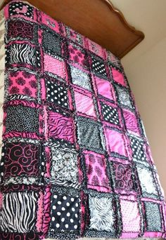 A beautiful rag quilt bedding in your choice of size (King, Queen, Full/double, and Twin). It comes in hot pink and black fabrics ranging from polka dots, to da