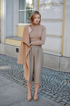 beige culottes, sweater, with camel coat, & nude heels