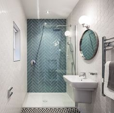 Ocean glass tile Large 4x12 installed in Herringbone pattern in shower. https://www.subwaytileoutlet.com/products/Ocean-Glass-4x12-Subway-Tile#.Valm1flViko