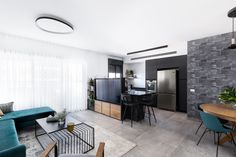 Black kitchen with tv in kitchen island טלויזיה באי במטבח שחור Conference Room, Table, Furniture, Home Decor, Decoration Home, Room Decor, Tables, Home Furnishings, Home Interior Design