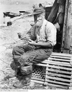 Portrait of a fisherman sitting on a lobster trap and holding a fishing net Canvas Art - x Old Pictures, Old Photos, Vintage Photographs, Vintage Photos, Art Sombre, Cultura Judaica, Lobster Trap, Old Fisherman, Vintage Fishing