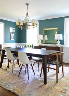 Dark green dining room! Love this paint color! Click through for sources and paint color details.