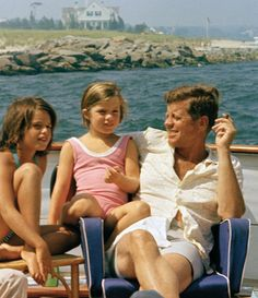 President Kennedy and Caroline relax on their boat