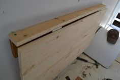 Forget IKEA -- Build your own Folding Desk! — Local Color XC Here's what you're working toward. It looks a lot like the IKEA version, if you ask us. Take note: see that pencil line? We drew that once Pinterest Desk, Murphy Table, Murphy Desk, Wall Mounted Table, Ikea Wall Table, Wall Mounted Desk Folding, Wall Table Folding, Wall Tables, Laundry Room Folding Table