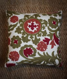 A charming cushion cover with pure wool hand embroidery handcrafted by artisans in Srinagar in effort to sustainably develop rural Kashmiri communities by upgrading intricate craft skills such as crewel embroidery. Srinagar, Embroidered Cushions, Crewel Embroidery, Cushion Covers, Effort, Artisan, Throw Pillows, Pure Products, Wool