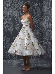 ROMANTICA FLORAL STRAPLESS GOWN Our sample dress available to try on in store is floor length Tea length available to order
