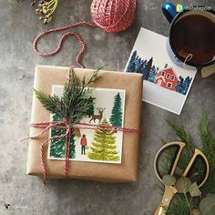 A beautiful use of holiday cards for a gorgeous gift wrapping effect! The little evergreen sprig, echoing the trees in the winter scene is a plus too!