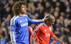 Hair-raising moment: Luiz pats Pereira on the head as the Benfica man is sent off Photo: REUTERS