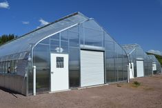 Although often overlooked as a particularly personalized element of your greenhouse construction, your end walls actually offer a unique opportunity to show a little creativity while matching your intended function. Tunnel Greenhouse, Greenhouse Frame, Backyard Greenhouse, Greenhouse Growing, Greenhouse Construction, Framing Construction, Construction Process, Farm Cafe, Commercial Greenhouse