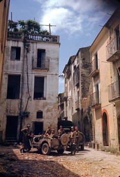 American troops rest in a courtyard during the drive towards Rome, World War II