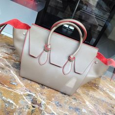 Celine's updated version of its Phantom bag:The Celine Tie Tote bag. I think the obsession is not over! Spotted at the brand's boutique in @the_avenues #celine #celinetietotebag #celinephantom #phantombag #Padgram