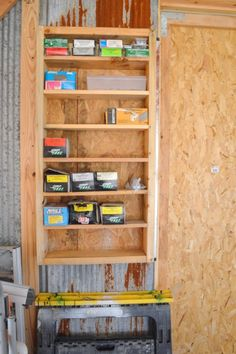 Garage Storage. Wall-mounted storage box for all of our nails/screws/hardware. The shelves are made to the same width as the boxes, so they don't get lost.
