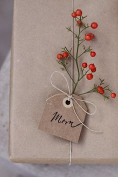 Wrapping gifts using foliage / Love and Lemons Creative / @landlcreative