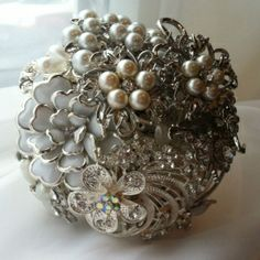 Ivory flower girl/bridesmaids brooch bouquet. Find these at www.thegbwedding.com!