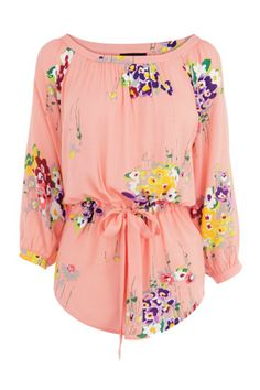Add a hint of pastel to your wardrobe with this fab floral tunic. The drawstring waist and 3/4 length sleeves with curved hem make for a Spring Summer style statement when worn with skinny jeans and pumps.