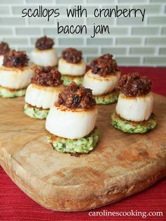 Scallops with cranberry bacon jam make for a stunning and delicious appetizer. Perfect for holiday entertaining or any excuse. Easy to make too. via /carolinescookng/