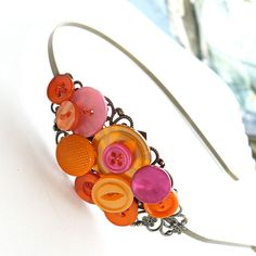 Bright Pink and Orange Button Cluster Headband $26 -- I like the premise. There are now several new ideas floating around with all of the other ideas floating around in my head.