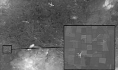 Russian state media shows purported satellite images of fighter jet intercept but White House says claim is 'preposterous'