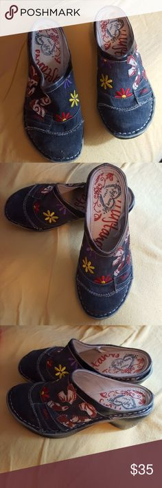 Mustang brand multi-colored slip-on clogs These are great Tama casual, fun easy slip on shoes. The background color is chambray Denim and the colorful flowers are red, purple and yellow . These have a slight wedge heel, they are complerely versitle too. mustang Shoes Mules & Clogs
