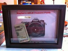 I love this idea. Start a savings shadow box with a picture of what they're saving for. This would also be cool for the kids, to teach them to save for something.-- I might print off some pics of the tattoos I want :)