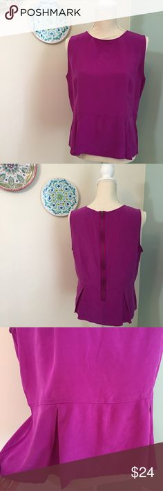 Fossil purple peplum top L Bright purple peplum top with zip up the back. In excellent condition! Size large. Fossil Tops Blouses