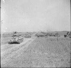 Sherman and Cromwell tanks of the Polish Armoured Division on the move at the start of Operation 'Totalise'. Normandy Ww2, Normandy Invasion, Normandy Beach, Cromwell Tank, D Day Landings, Sherman Tank, Ww2 Tanks, Submarines, World War Ii
