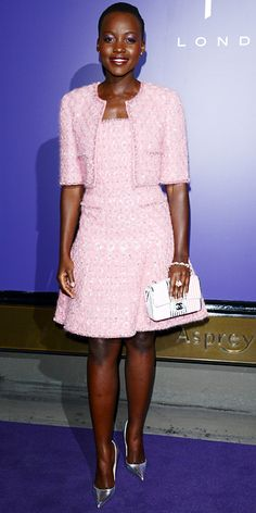 72d5784e05fb Lupita Nyong'o wearing a pink tweed Chanel Couture jacket-and-dress set