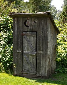 This outdoor toilet (no longer in use) is found on the grounds of Tretheway House in Abbotsford, B.C., a historical home, museum and tea house.    An Outhouse is also known as a Biffy, Can, Dunny or Thunderbox, depending on what part of the world you're in.