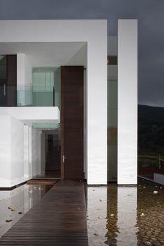 Minimalist House // oversized wood entry door at the Casa del Agua, Jalisco, Mexico by Almazán Arquitectos Asociados
