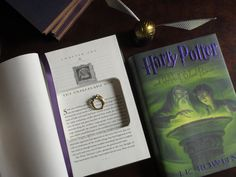 Harry Potter: Half-Blood Prince (Ring Bearer) - Book Safe | Secret Safe Books Harry Potter Half Blood, Wedding Jewellery Boxes, Harry Potter Shop, Secret Safe, Book Safe, New Year Photos, Ribbon Bookmarks, Library Card, Ring Bearer