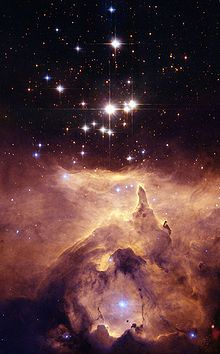 """NGC 6357 - The nebula contains many proto-stars shielded by dark disks of gas, and young stars wrapped in expanding """"cocoons"""" or expanding gases surrounding these small stars. This nebula was given the name War and Peace Nebula by the Midcourse Space Experiment scientists because of its appearance. They said that in infrared images the bright, western part resembles a dove, while the eastern part looks like a skull.["""
