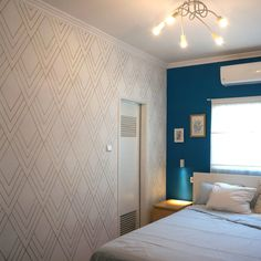 $15 + 6 hours: Make a breathtaking accent wall, with the fraction of the cost of a real wallpaper. A simple DIY, affordable on a budget project with a sharpie marker pen.