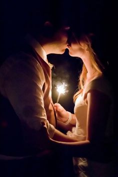 Bride and groom with a sparkler Love it