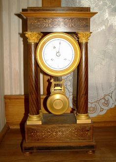 French column (portico) clock 1840  http://www.timemaster.nl/mangumwhitehouse-clock-museum/
