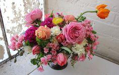 Floral arrangement / Pink Centerpiece by Sachi Rose. Includes garden roses, orange poppies, peach ranunculus, azaleas, tulips, narcissus, etc.