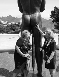 "Santa Cruz. Tenerife. by David Dutton  •  Photographer quote:  ""What lady can resist stroking such a fine figure of a man? These ladies couldn't."""