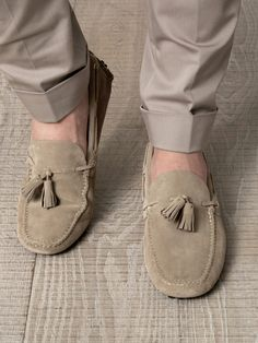 Beige slip-on suede loafers from Car Shoe with a square toe and tassel detail. Offering the best in handmade craftsmanship, the Italian label lends panache and flair to a wardrobe classic with these luxury driving shoes.
