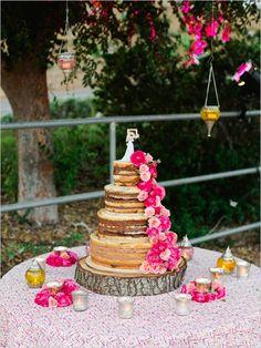 Naked wedding cake, with vintage wedding cake topper.