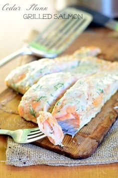 Amazing Cedar Plank Salmon smothered in creamy lemon dill sauce for you to grill this summer!